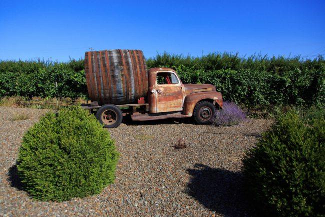 Antique truck with huge wine barrel at Cassini Cellars, Oliver. Winning Wines: The Aristocrat, Cabernet Sauvignon 2013, and Nobilus, Merlot Collector's Series 2013.
