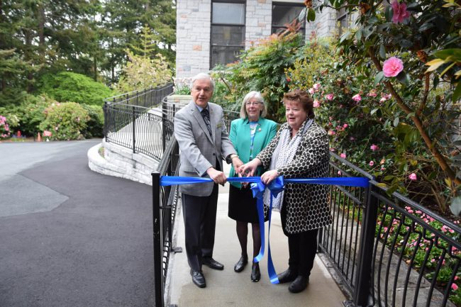 Colin Smith, Trustee, Government House Foundation and MLA Linda Reid, former Speaker of the Legislative Assembly, help Lt.-Gov. Judith Guichon cut the ribbon to open the new ramp entry at Government House